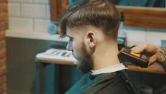 Barber shaves customers nape Stock Footage