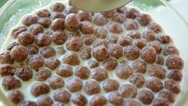 Stock Video Footage of Close up of Bowl of Chocolate Cereal with Milk