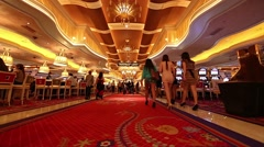 2 angles young attractive people walking inside the wynn hotel red carpet Stock Footage