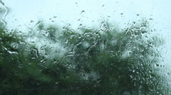 Rain drops on glass Stock Footage