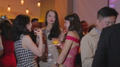 3 angles - glamorous young Asian girls and professionals in chic lounge Stock Footage