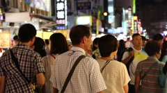 3 angles - Taiwan night market - crowd of people assorted food - stock footage