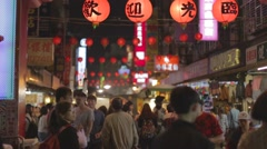 3 angles - Taiwan night market  red lanterns and meat skewers Stock Footage