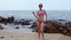 Young Woman Dancing Salsa on the Beach Stock Footage