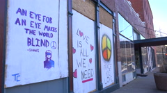 Residents of Ferguson, Missouri displays signs supporting their community - stock footage
