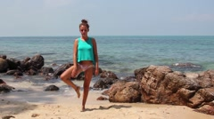 Young Woman Doing Yoga On The Beach Stock Footage