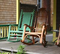 Stock Photo of Rocking Chairs on a Victorian Porch House