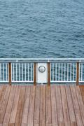 Wooden Dock and Banister on the Sea - stock photo