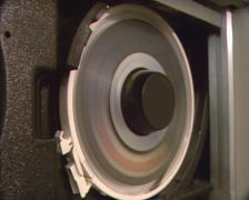 Spinning magnetic tape in tape drive, open reel, storing computer data  (1980s) Stock Footage