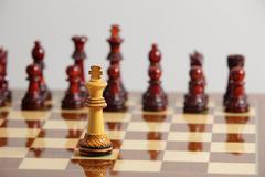 Chess king alone in danger - stock photo