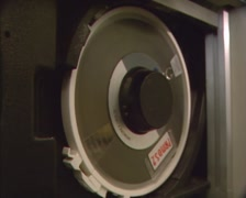 Operator takes out the open reel magnetic tape from tape drive (1980s) Stock Footage