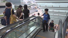 Busy escalator step moving staircase outdoor Hong Kong downtown people travel  Stock Footage