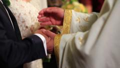Priest benediction of united hands of bride and groom Stock Footage