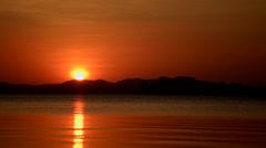 Orange sun set sea timelapse Stock Footage