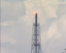 GRONINGEN, THE NETHERLANDS - Flare stack + zoom out shed in rural landscape Stock Footage