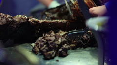 Slicing off grilled steak on a cutting board Stock Footage