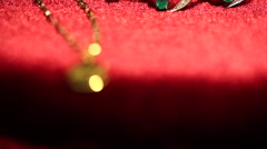 Golden lucky pendant necklace shifting focus Stock Footage