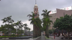 Timelapse city life Hong Kong center palm tree blow windy day rainy monsoon    Stock Footage