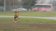 People play rugby on the field - stock footage