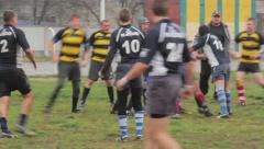 People play rugby on the field Stock Footage