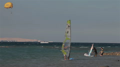 LEARNING TO WIND SURF ON RED SEA, HURGHADA, EGYPT Stock Footage