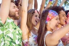 Happy hipsters listening to live music - stock photo