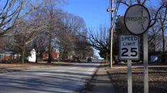 Roadside sign indicates an entrance to a suburban neighborhood in Ferguson, - stock footage