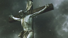 Cemetery Crucifixion Statue in Snow - stock footage