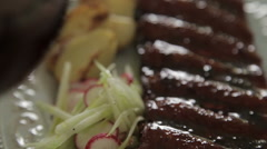 Pork ribs with baked potatoes 003 Stock Footage