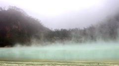 Fog Above Volcanic Sulfur Lake Stock Footage