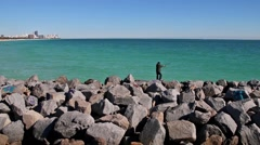 Lone Fisherman On Rock Jetty South Point Clip 2 Stock Footage