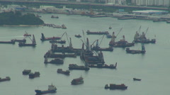 Timelapse industrial harbor Hong Kong crane machine work deliver ship cargo boat Stock Footage