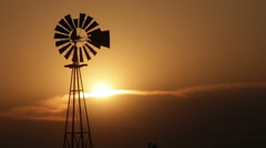 Windmill Silhouette at Sunset Stock Footage