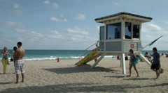 Lifeguard station in Florida, with ocean view and pedestrians Stock Footage