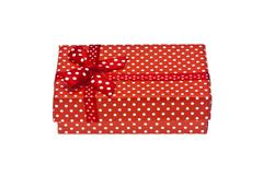 Red gift box with ribbon isolated on a white background Stock Photos
