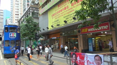 Pedestrian people cross street commercial district Hong Kong downtown rush hour  Stock Footage