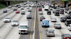 Zoom Out / Overhead View of Traffic on Busy Freeway in Downtown Los Angeles Stock Footage