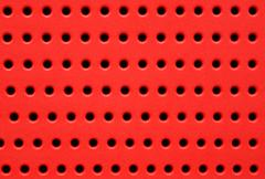 red perforated plastic background - stock photo