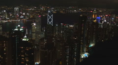 Pan left Hong Kong panorama night amazing skyscraper view landmark iconic emblem Stock Footage