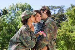 Army parents reunited with their son - stock photo