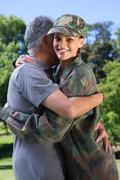 Soldier reunited with her father - stock photo