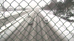 Highway traffic in snow storm push to warning sign Stock Footage