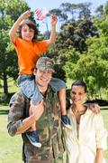American soldier reunited with family - stock photo