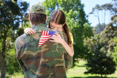 American soldier reunited with daughter - stock photo