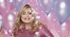 Beautiful young woman dancing celebrating birthday party pink and blue balloon Stock Footage