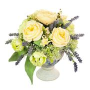 Bouquet from artificial flowers arrangement centerpiece in old vase. - stock photo