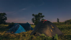 Moving night sky with stars and clouds above tents. Visible constellation Ursa Stock Footage