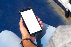 Stock Photo of Female Hand Holding Smart Phone