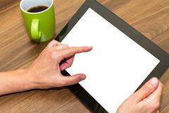 Stock Photo of Hand Holding Tablet with Blank Screen