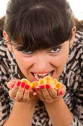 Young girl overeating junk food Stock Photos
